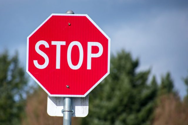 Stop sign against the sky