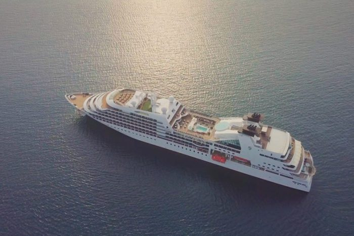 seabourn sojourn Luxury cruise ship sailing across The Ocean on beautiful sunset light - Aerial footage