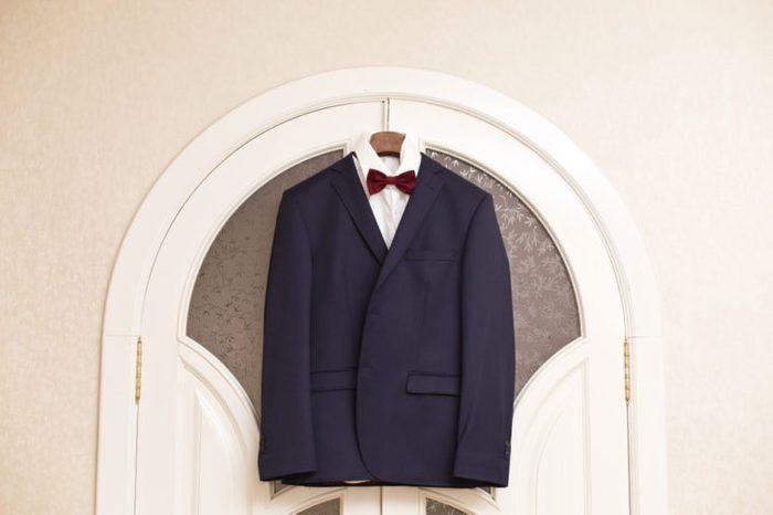men's suit hanging on trempel. Groom's suit