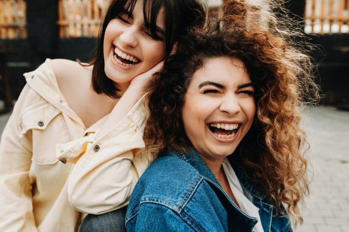Amazing girls laughing and having fun together.