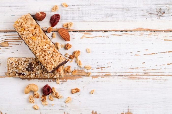 Top view of various healthy granola bars (muesli or cereal bars). Set of energy, sport, breakfast and protein bars isolated on white background