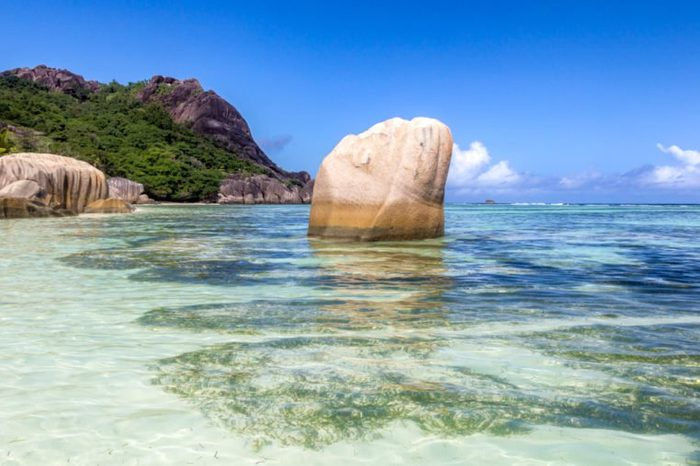 Granite rocks and turqouise water at the tropical beach Anse Source d'Argent on La Digue, Seychelles.