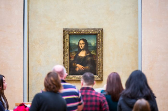 "PARIS, FRANCE - FEBRUARY 06, 2016: Visitors take photo of Leonardo DaVinci's ""Mona Lisa"" at the Louvre Museum"