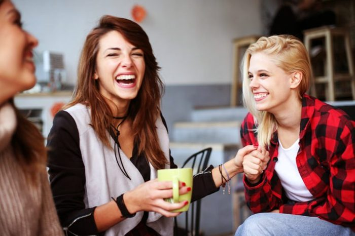 Friends having fun in a cafe.