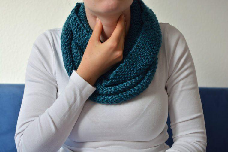 Woman having a sore throat