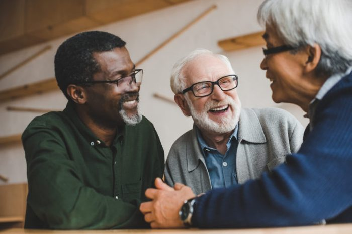 group of multiethnic senior friends spending time together and laughing