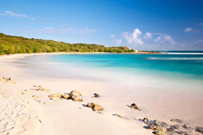 Daytime long exposure of the beautiful Half Moon Bay in Antigua.