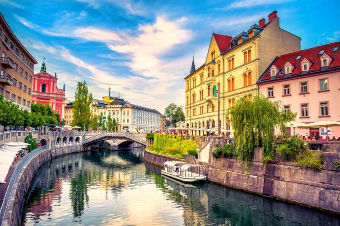 Cityscape view on Ljubljanica river canal in Ljubljana old town. Ljubljana is the capital of Slovenia and famous european tourist destination.