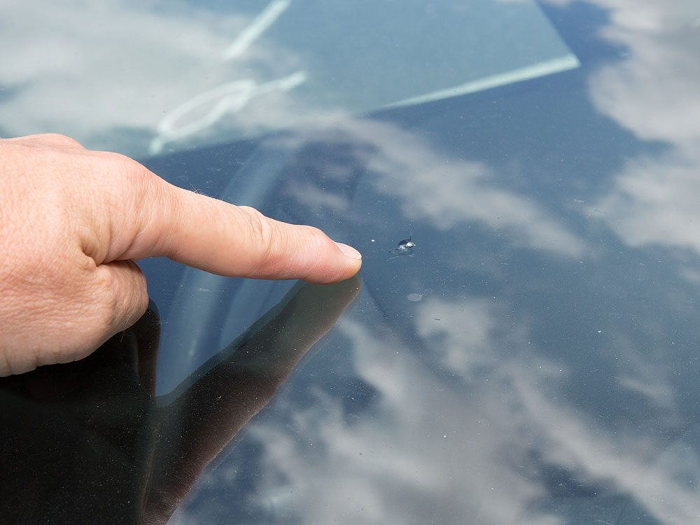 Use nail polish to stop a windshield chip from spreading