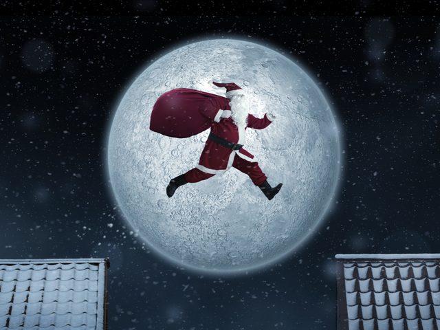 Santa jumping between houses