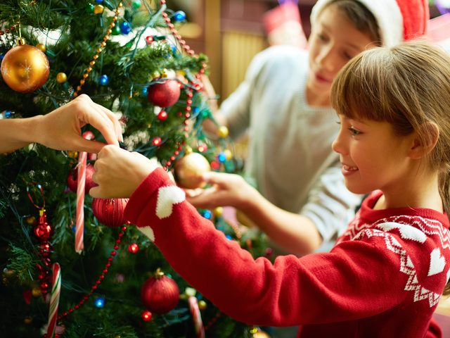 Kids decorating tree