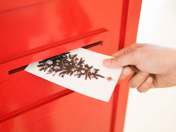 Person mailing Christmas card