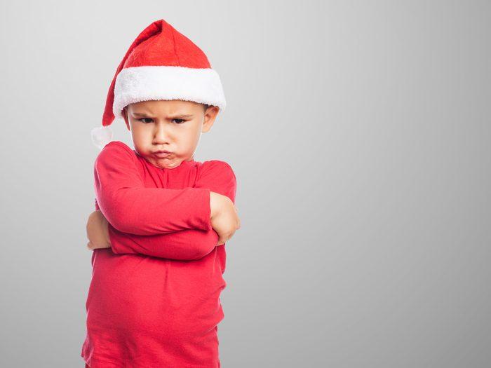 Grumpy kid in santa hat