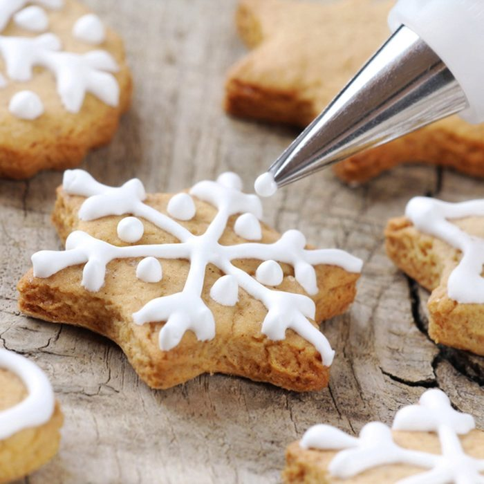Christmas cinnamon cookies icing decorating process with a pastry bag