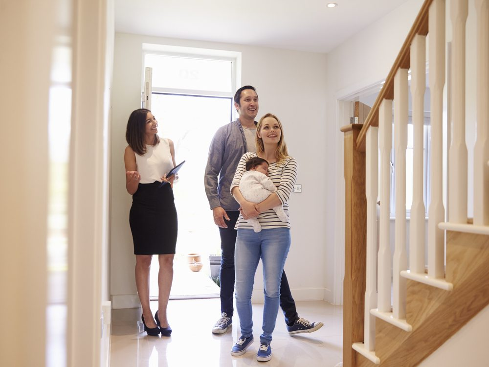 Real estate agent with young family