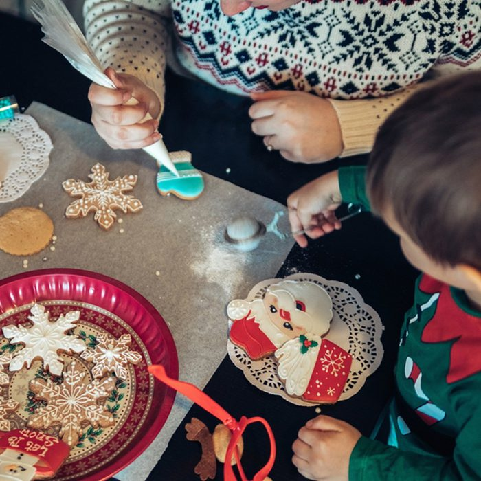 Cute Boy And A Woman Decorating Gingerbread Cookies
