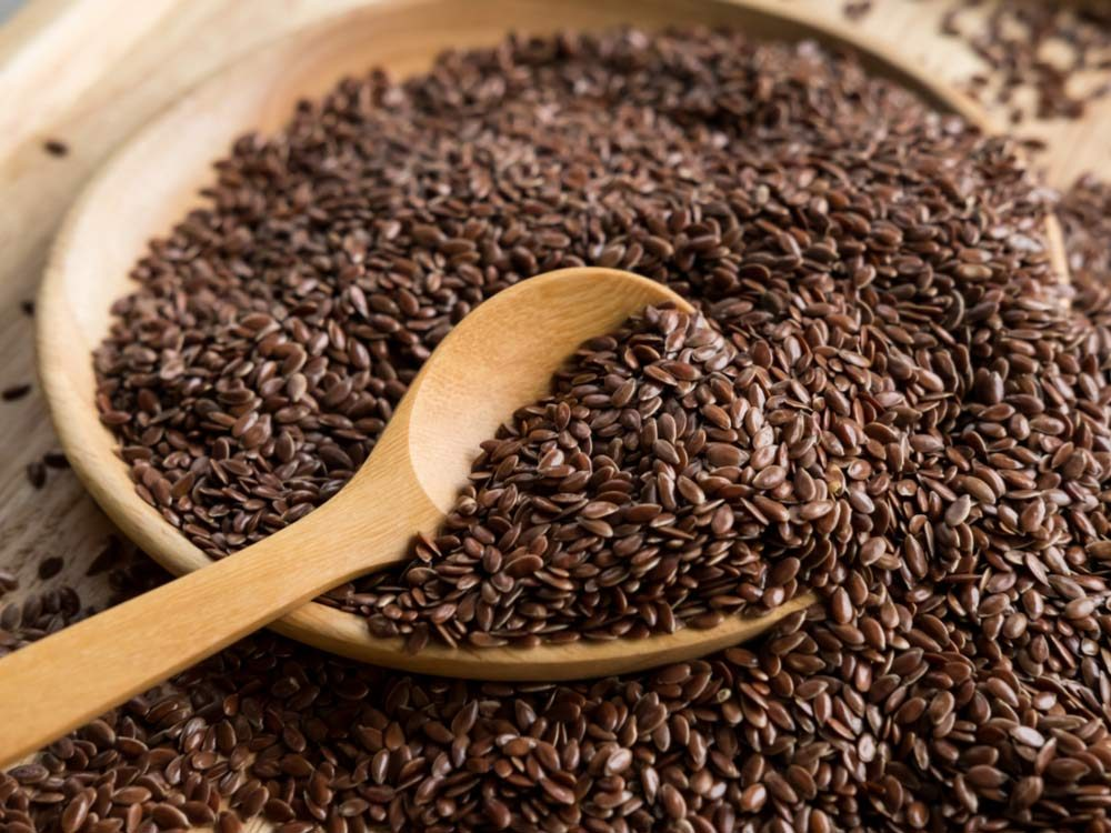 Flaxseeds in wooden bowl