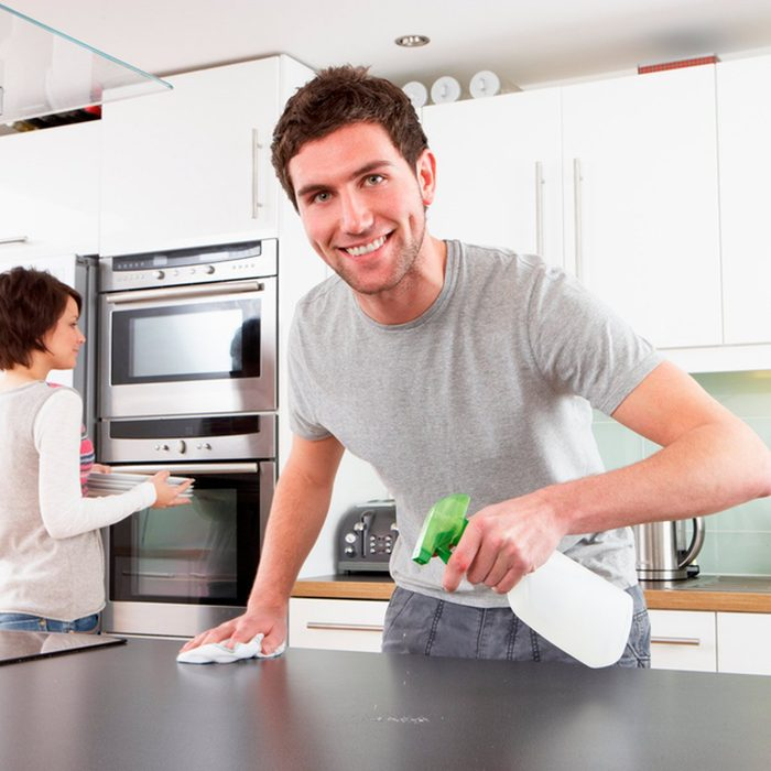 Man cleaning his kitchen