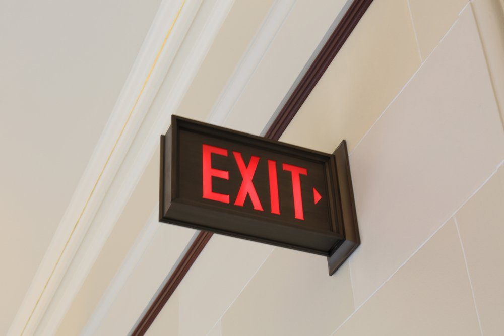Emergency exit sign hanging on the wall