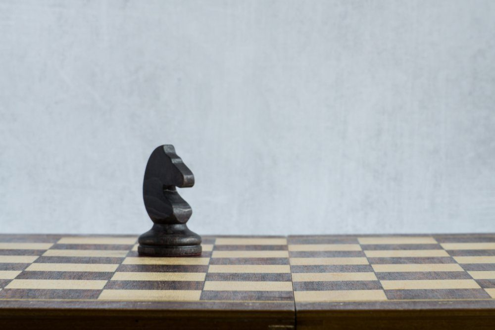 A lonely black horse on the chessboard