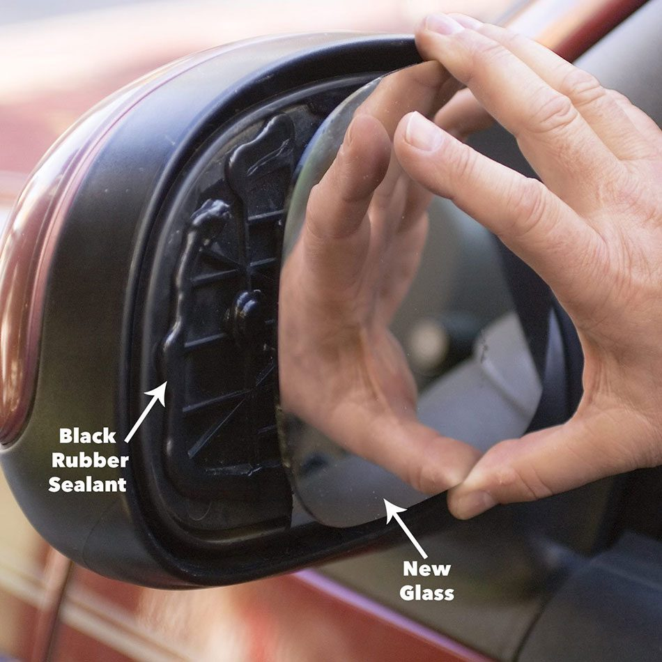 Apply sealant to the new side view mirror