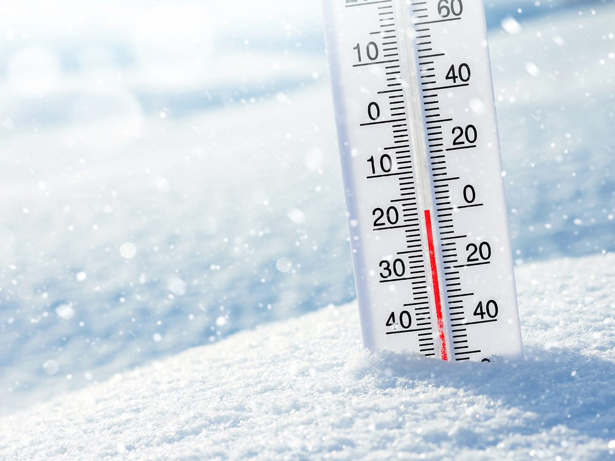 Frostbite symptoms - thermometer in snowbank freezing