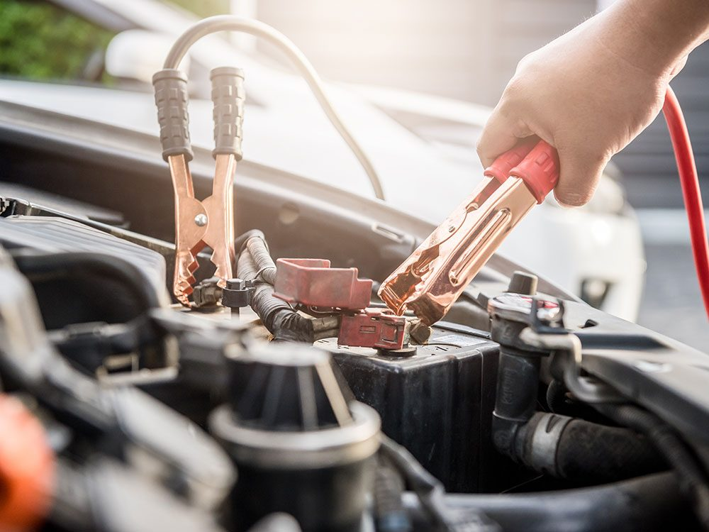 Using jumper cables to jump-start a car