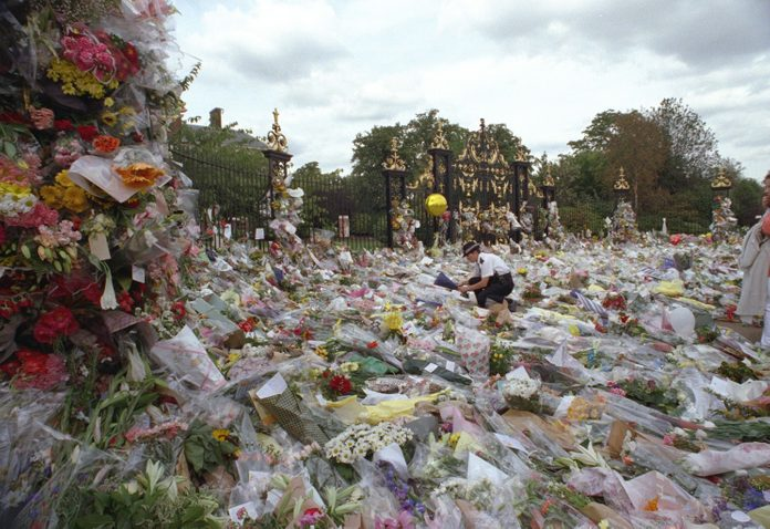 All Pictures Show The Massive Floral Tributes Outside The Gates Of Kensington Palace Which Also Shows A Lone Policewoman Helping With The Distribution The Contributions Were The Biggest In London After The Tragic Death Of The Princess Of Wales Who Wa