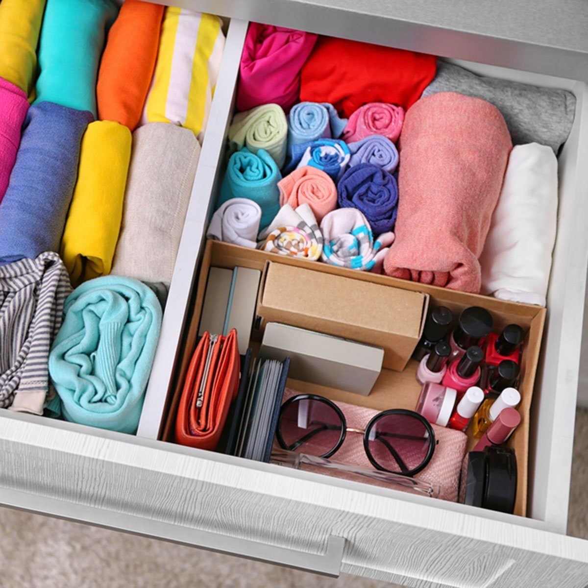 Neatly folded clothes with accessories in chest of drawers; Shutterstock ID 453967519; Job (TFH, TOH, RD, BNB, CWM, CM): Taste of Home