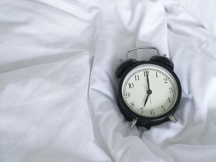 worst time of day to have sex - clock on bed