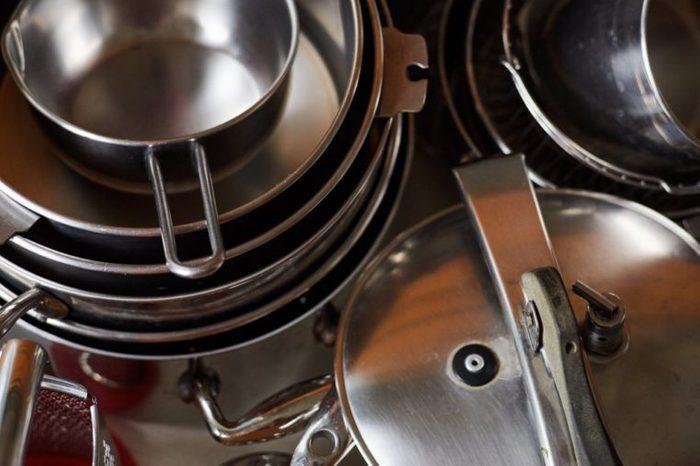 steel pots in a drawer