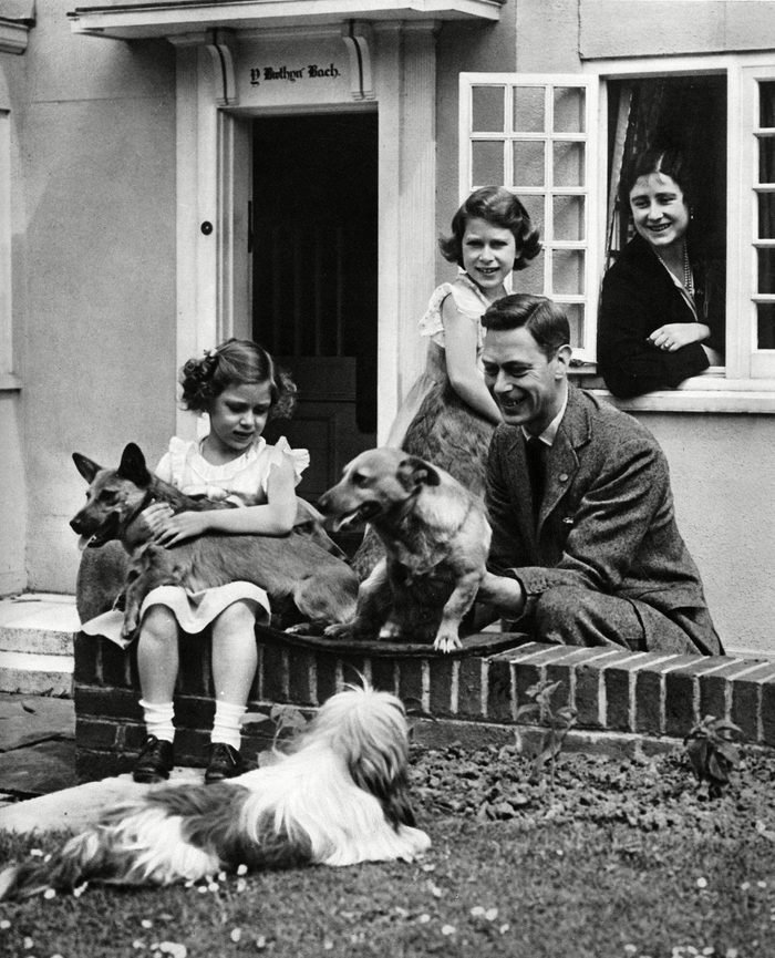 The Duke and Duchess of York Later King George Vi with Their Children Princess Elizabeth and Princess Margaret and Some of Their Dogs an Informal Portrait at Princess Elizabeth's Miniature House House at the Royal Lodge Windsor the House Was A Gift From the People of Wales As A Sixth Birthday Gift For Princess Elizabeth(later Queen Elizabeth Ii) 1933