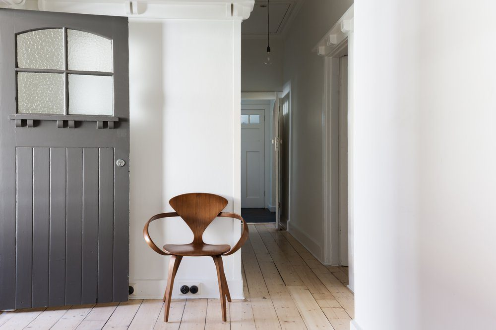 Simple decor of classic wooden chair in renovated apartment entry horizontal