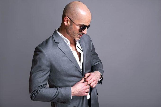 Bald man in a grey suit