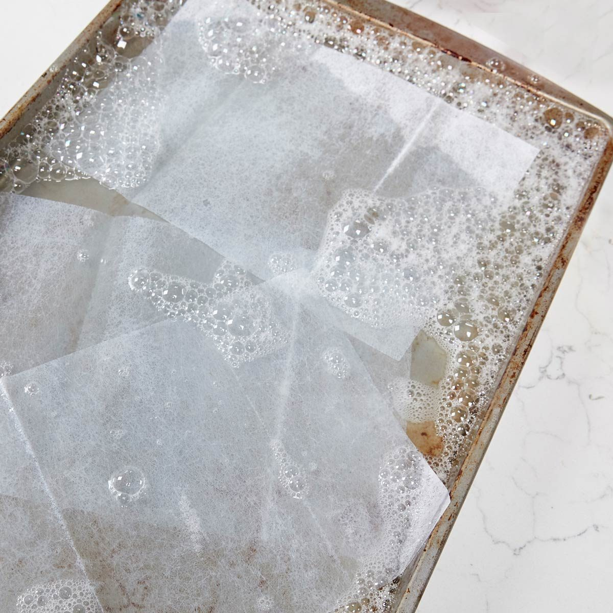HH soak burnt pan with dryer sheets