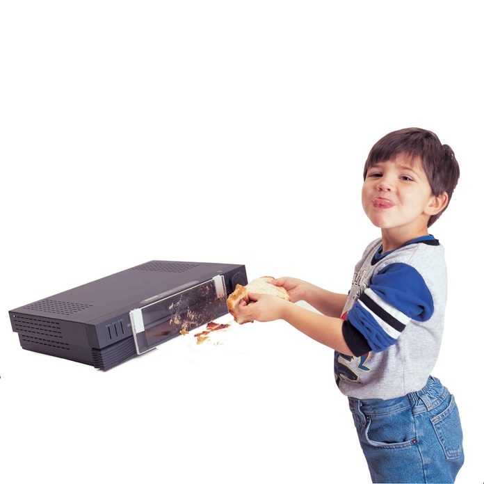 Little kid with his VCR player