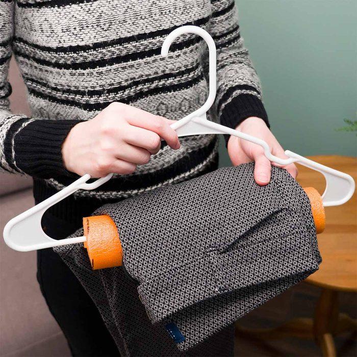 pool noodle hanger hack with dress pants