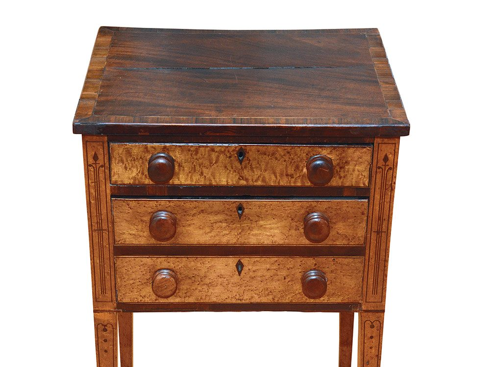 Two-drawer Sheraton stand belonging to an antique collector