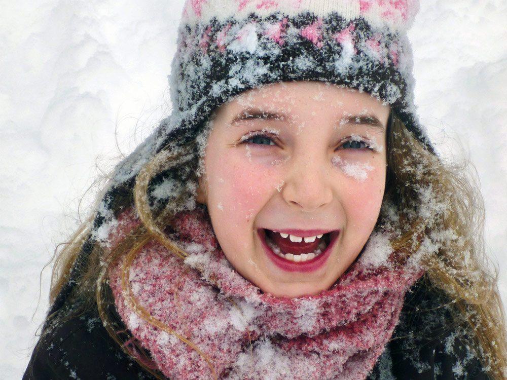 Little girl happy in winter