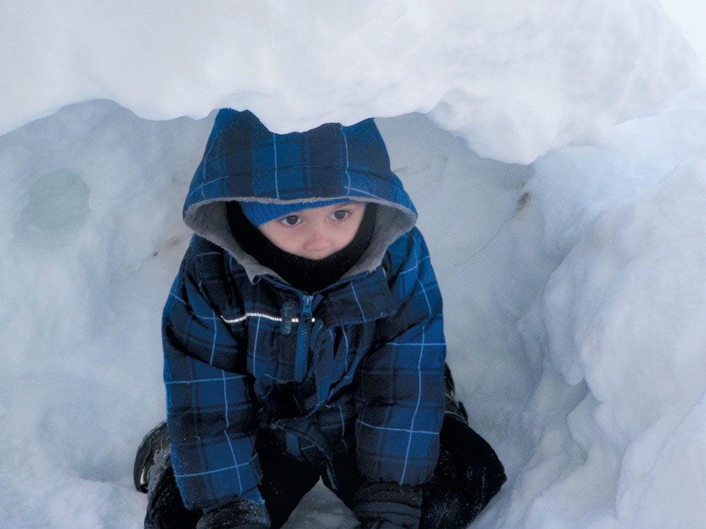 Child in igloo