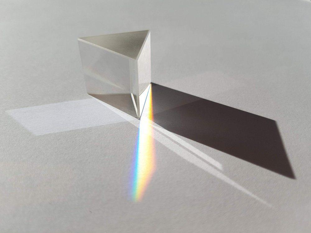 minimalistic glass pyramid geometry with sadow and rainbow
