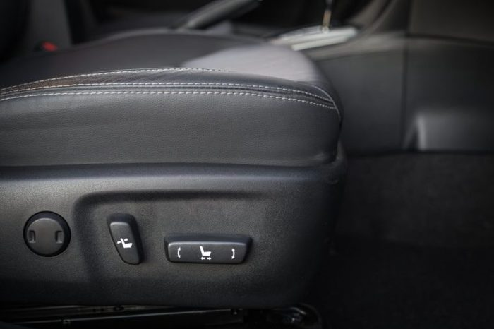Detail of new modern car interior, Focus on seat adjust switch