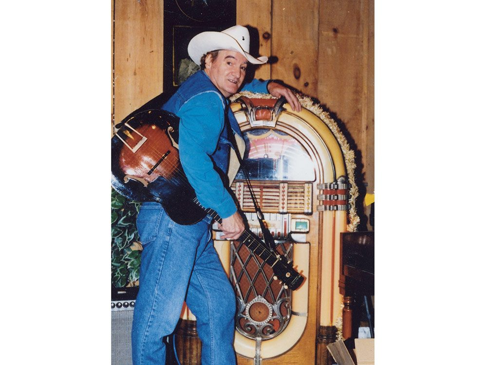 Michael T. Wall standing next to his vintage jukebox