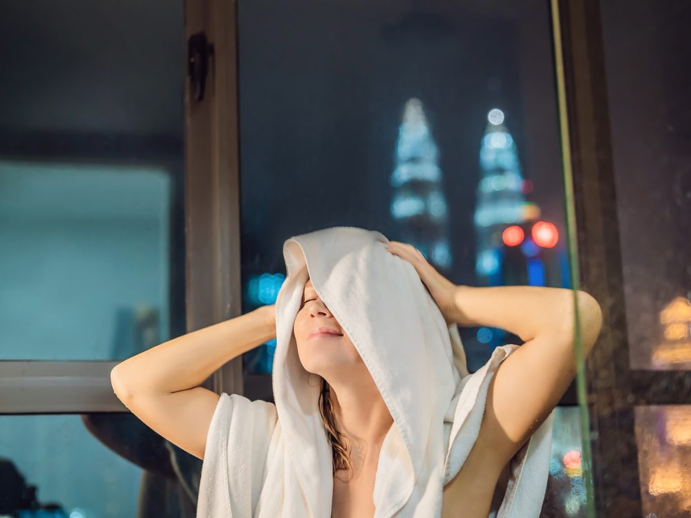 Woman drying herself off after bath