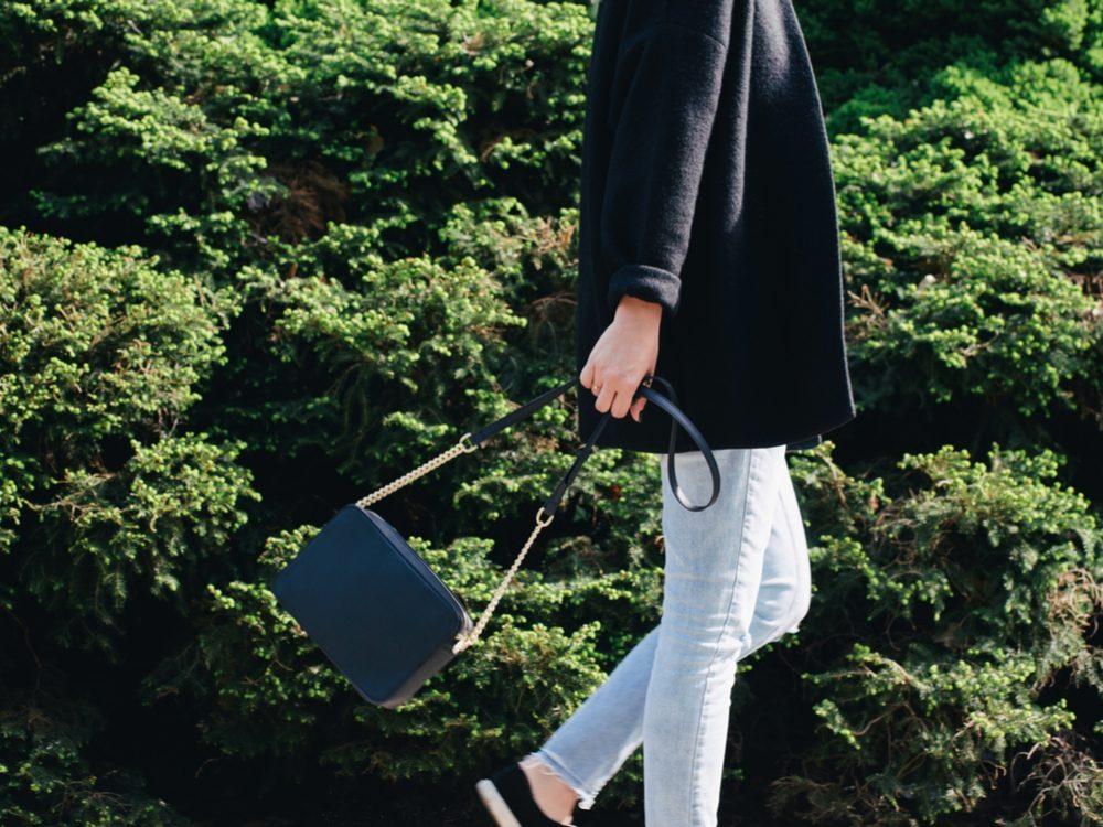 Woman walking and carrying her handbag