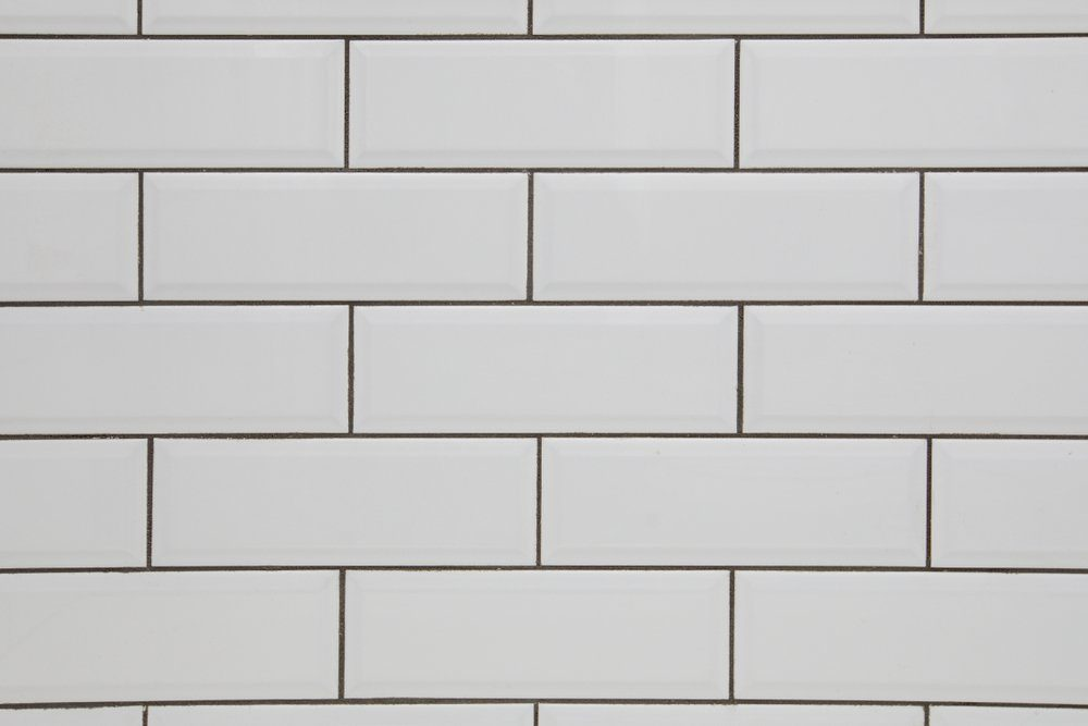 White subway tile wall and dark grout for a kitchen or bathroom backsplash