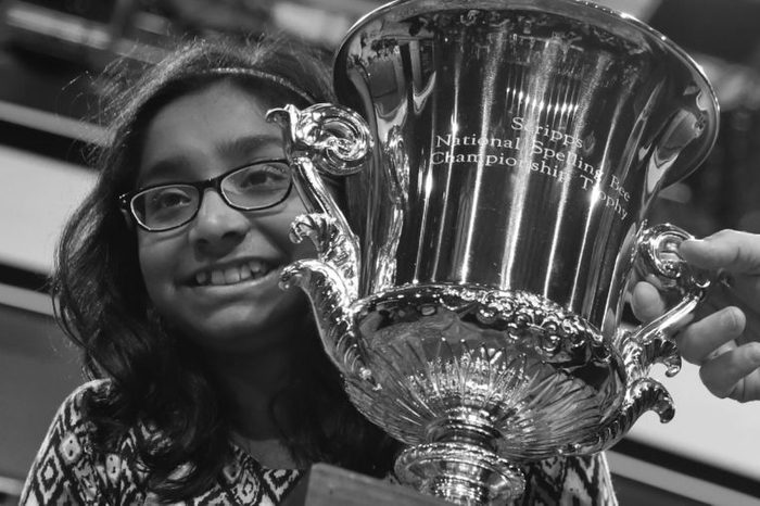 Ananya Vinay, 12, from Fresno, Calif., holds the trophy after being declared the winner of the 90th Scripps National Spelling Bee, in Oxon Hill, Md