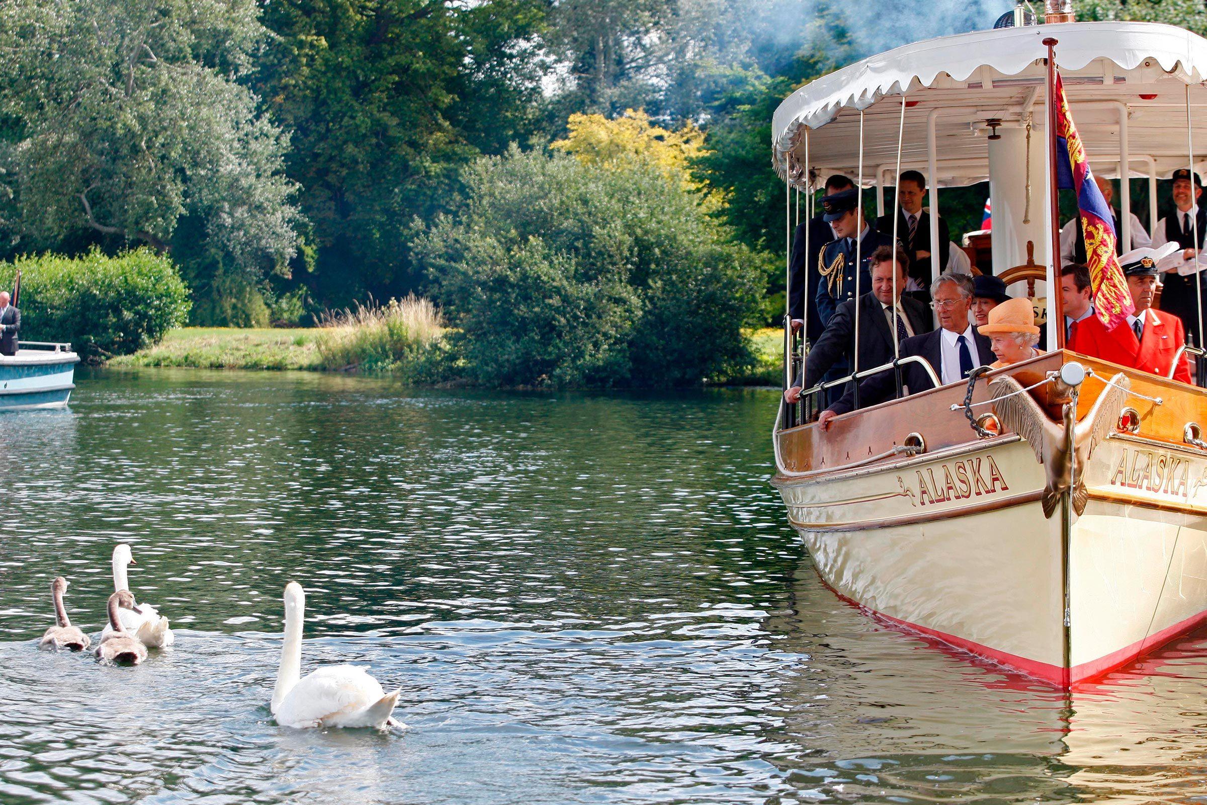 Queen Elizabeth II watching swans