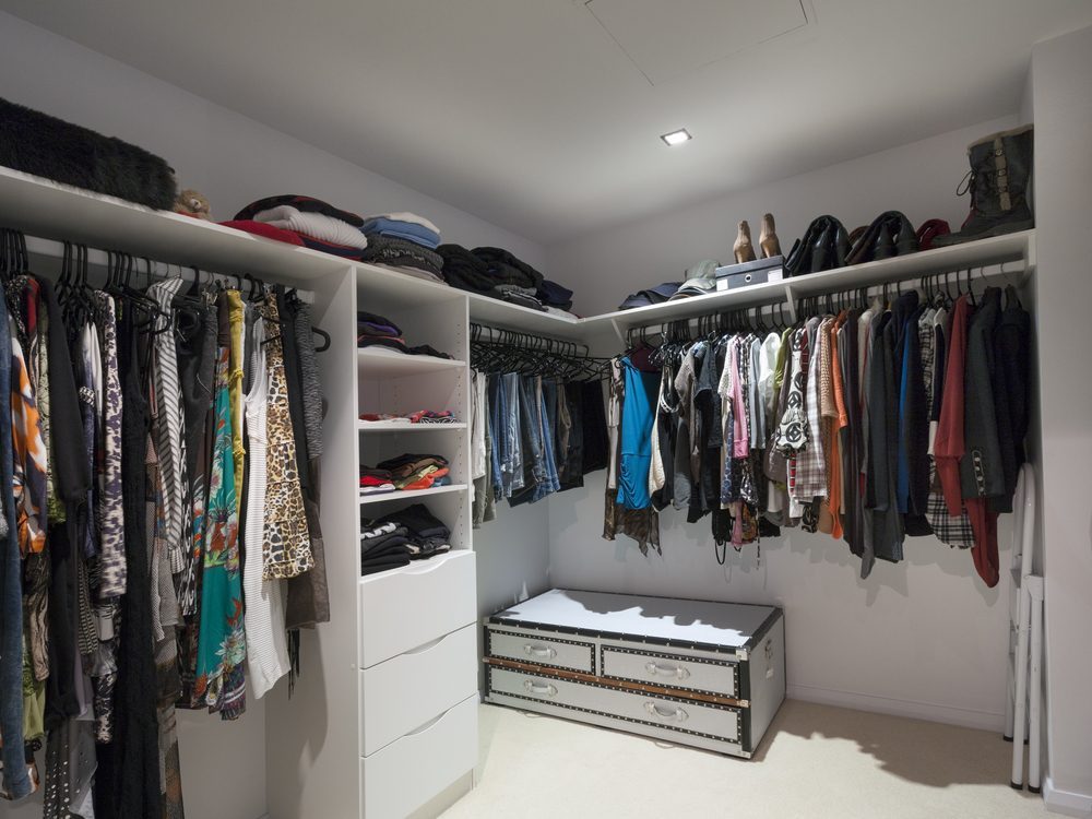 Walk-in closet with clothes