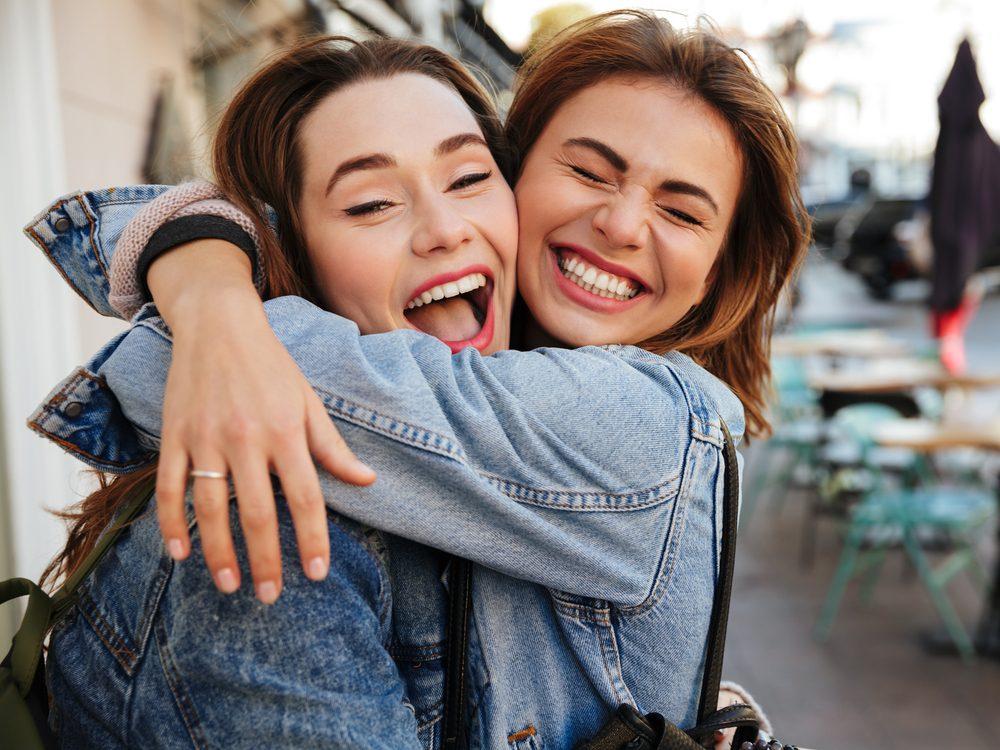 Two female friends hugging